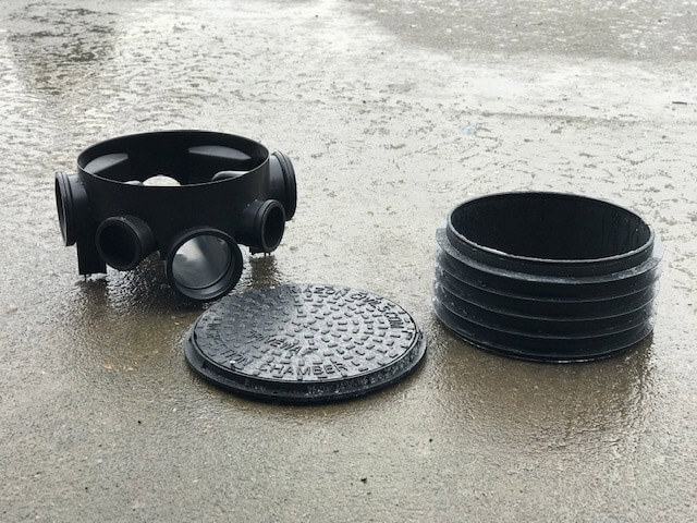 Manhole base, riser and lid